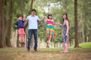A family having fun at the park in Singapore. Photography by Masakecil.