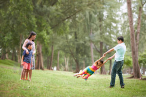 A family having fun at the Singapore's park. Photography by Hendra Lauw.